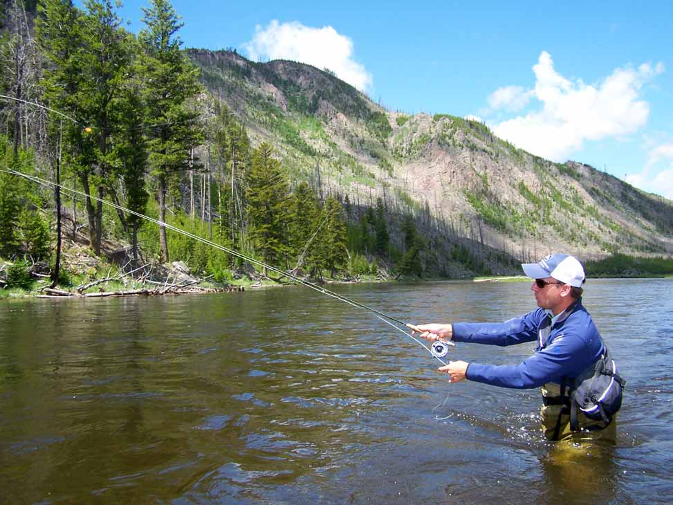 Man fly fishing in Yellowstone river